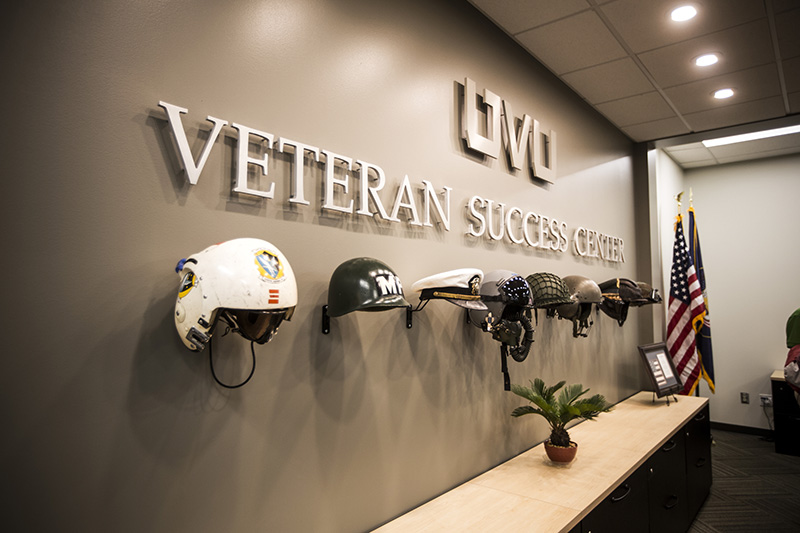 Veteran Success Center wall displays different helmets